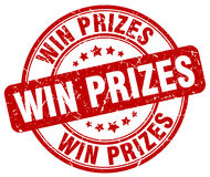 Win prizes red grunge round vintage stamp Royalty Free Stock Photo