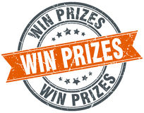 Win prizes round orange grungy vintage stamp Stock Photography