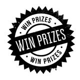 Win prizes stamp. Grunge design with dust scratches. Effects can be easily removed for a clean, crisp look. Color is easily changed Stock Photos