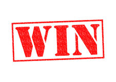 WIN Rubber Stamp. Over a white background Stock Photography