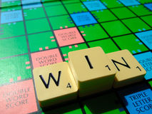 Win scrabble. Scrabble word and boards. In the shape of a podium. Great for news articles on success and competition Royalty Free Stock Image
