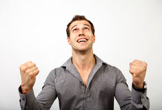 Win or succes concept - man happy for his luck Royalty Free Stock Image