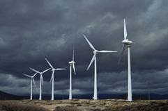 Win turbines and dark clouds Tenerife Spain royalty free stock photo