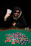 Win with two aces in poker. Man shows two aces and win hand in poker casino with chips on green felt Royalty Free Stock Images