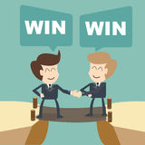 Win win businessman with shake hands on cliff Stock Image