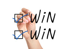 Win Win Check Marks. Hand putting check mark with blue pen on Win Win Royalty Free Stock Photography
