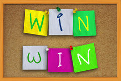 Win Win Concept. The words Win Win written on sticky colored paper over cork board Stock Photos