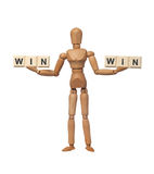 Win-win. Figurine with the word WIN on both hands depicting a win-win situation royalty free stock photo