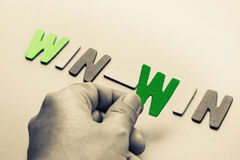 Win-win. Hand arrange wood letters as Win-Win phrase for business concept Stock Image