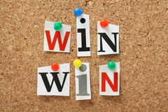 Win Win Situation. The phrase Win Win in cut out magazine letters pinned to a cork notice board. In any transaction or undertaking we look for mutual benefits Royalty Free Stock Image