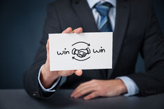 Win win strategy. Win-win partnership strategy concept. Businessman with drawn win-win scheme on card and handshake partnership agreement royalty free stock photography