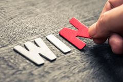 WIN WOOD LETTERS Stock Images