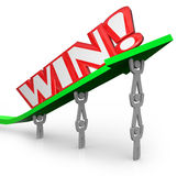 Win Word on Arrow Teamwork Lifting for Success Stock Photo