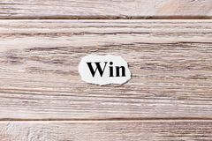 Win of the word on paper. concept. Words of Win on a wooden background.  Royalty Free Stock Photography