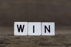 Win, written in cubes Stock Image