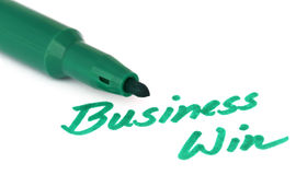 Win written  on a paper with pen Royalty Free Stock Images