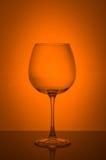 Wina szkło na pomarańczowym tle Fotografia Stock