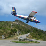 Winair plane landing at St Barts airport. ST. BARTS, FRENCH WEST INDIES - JANUARY 21, 2006: Winair plane landing at St Barts airport. St. Barts is considered a royalty free stock images