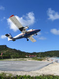 Winair plane taking off from St Barts airport. ST. BARTS, FRENCH WEST INDIES - JANUARY 21, 2005: Winair plane taking off from St Barts airport. St. Barts is royalty free stock photos