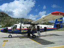 Winair plane on tarmac at St Barts airport. ST. BARTS, FRENCH WEST INDIES - JANUARY 23, 2005: Winair plane on tarmac at St Barts airport. St. Barts is royalty free stock images