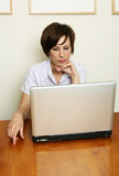 Winan looks at the laptop Stock Images