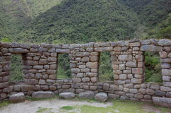 The Winay Wayna ruins on the Inca Trail. A wall with windows inside the Winay Wayna ruins on the Inca Trail Royalty Free Stock Image