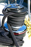 Winch with black rope. Winch on sailing boat with black cord Royalty Free Stock Photo