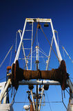 Winch on a Boat. A winch on an old fishing boat Stock Images