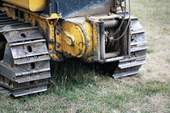 Winch and bull dozer tracks. Rear view of a winch and tracks of a bull dozer excavating machine Stock Images