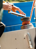 Winch capstan with rope on sailing boat. Royalty Free Stock Photos