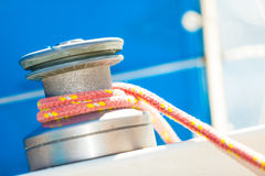 Winch capstan with rope on sailing boat. Royalty Free Stock Image