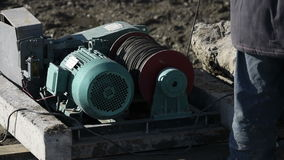 Winch at a construction site stock footage