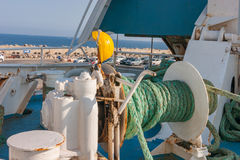 Winch with green rope on ferry. Green nautical rope on old, rusty ferry winch Stock Images