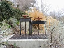 Winch of pair of  irrigation ditch gates against sky with tall grass in Memory Grove Park in Salt Lake City Utah along the Wasatch Royalty Free Stock Photos