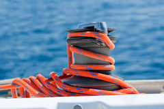 Winch with red rope on yacht Royalty Free Stock Images