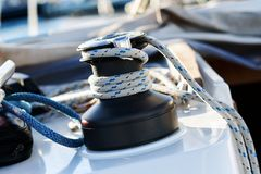 Winch with rope on sailing boat Royalty Free Stock Image