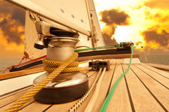 Winch with rope on sailing boat in the sea Stock Image