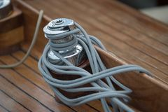 Winch with rope on a wooden boat stock photography