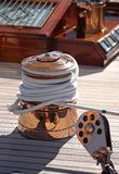 Winch on sailing yacht. Polished brass capstan winch on luxury sailing yacht Royalty Free Stock Photo