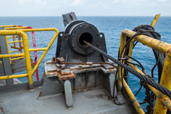 Winch system of boat anchor. On offshore rig stock photos