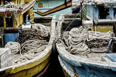 Winches and coiled ropes on woden fishing boats Royalty Free Stock Photos
