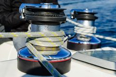 Winches with mainsail and genoa sheet ropes. Royalty Free Stock Image