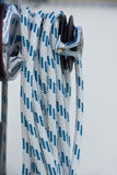 Winches and ropes, sailing yacht detail. Vertical shot Stock Photo