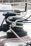 Winches on a sailing boat. Winches with ropes on a sailing boat stock photography
