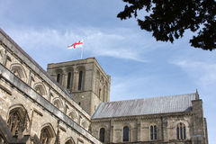 Winchester cathedral. Shot of Winchester cathedral showing St George cross in afternoon sunshine stock image