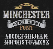 Winchester label font whith decoration design. Old style. Royalty Free Stock Image