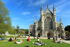 Winchester. The people relaxing ahead of Winchester Cathedral Stock Photos