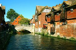 Winchester river Itchen bridge and old town, Hampshire, UK, on a stock images