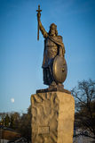 Winchester. The statue of Alfred the Great in the historic city of Winchester. The moon rises in the sky behind Stock Photography