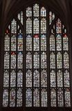 Winchester Cathedral stained glass window. Winchester, United Kingdom - April 29 2018: The stained glass west window of Winchester Cathedral, which was smashed royalty free stock image